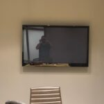 The original dated TV installed in the boardroom before it was revamped.