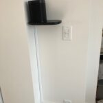 We mounted the client's Sonos speakers on supplied shelves and cleanly ran the power cable down the wall as the inside of the wall was solid.